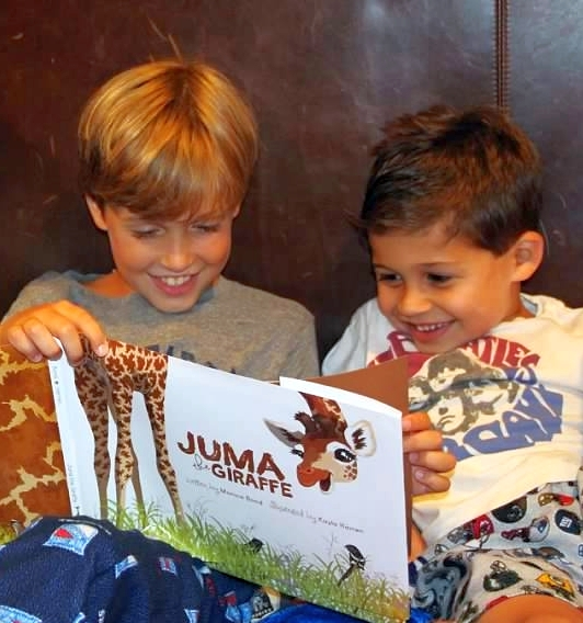 Picture of Two happy kids enjoying Juma the Giraffe. Wild Nature instiute